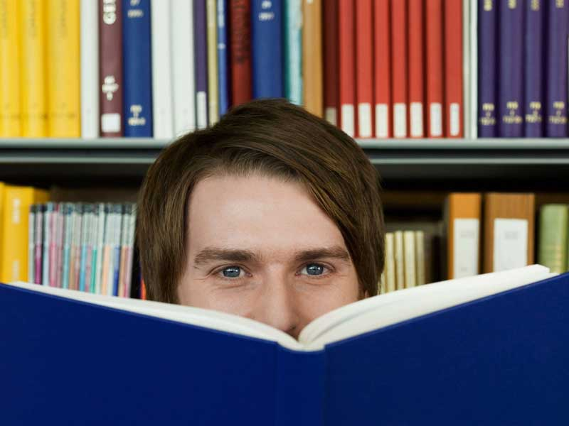 Man looking over a book