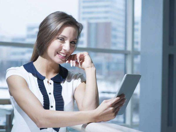 Business woman looking at an ipad