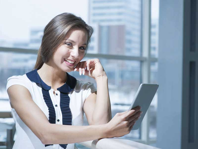 Business woman looking at an ipad